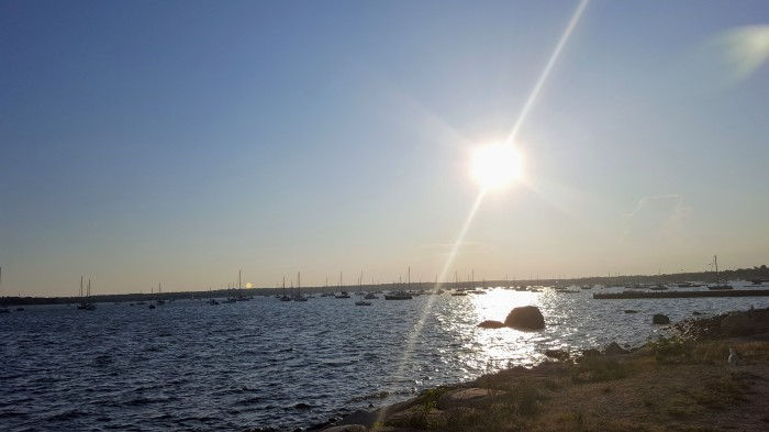A photo of the sun setting over Mattapoisett Harbor in Mattapoisett, MA on Buzzards Bay